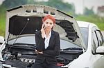 woman-with-car-broke-down-100216056
